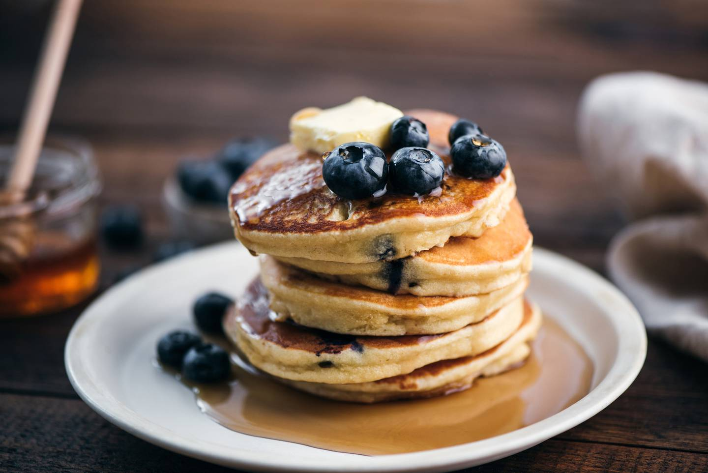 You can't go past pancakes for a Father's Day breakfast. Photo / Getty Images