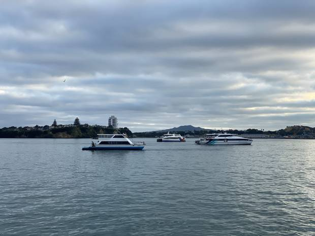 Ferries circle this morning, waiting for the Queen Elizabeth to finish docking. Photo / Chris Keall