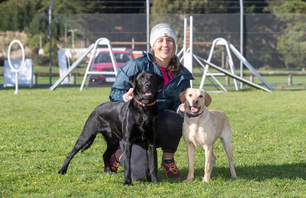 Erin Moyle, with Marco, left, who failed as a police dog, and Poppy, who is currently in training. Photo / Mark Mitchell