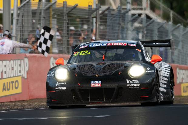 Matt Campbell drives the Porsche 912 to claim the checkered flag. Photo / Getty Images