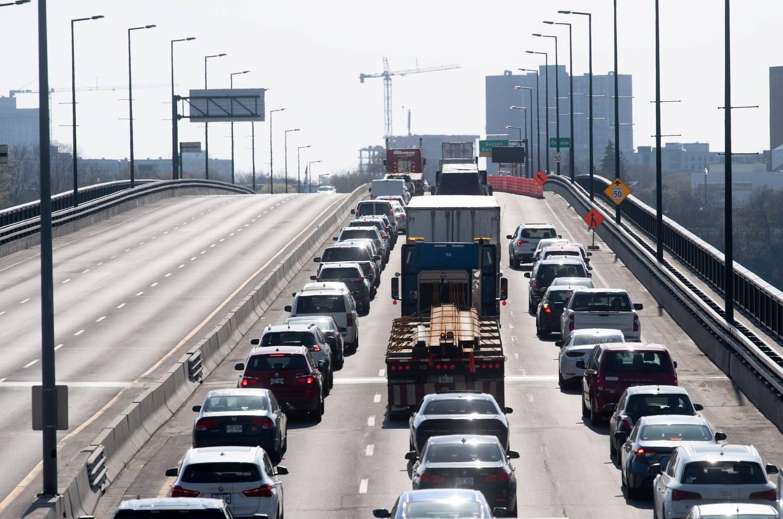 Vehicles entering Ontario from Quebec cross an interprovincial bridge in Ottawa. Photo / AP