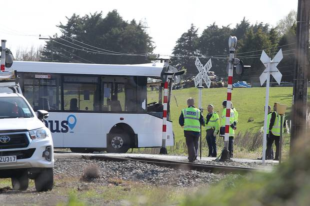 Police at the scene where the driver of a bus carrying students to Feilding High school was killed in a level crossing crash near Bunnythorpe. Photo / Bevan Conley