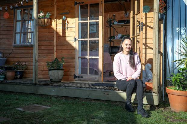 Susan Gedye outside the cottage built for her to work out of. Photo / Andrew Warner