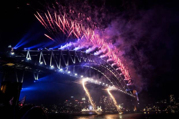 The midnight fireworks light up the Sydney Harbour Bridge. Photo / Getty