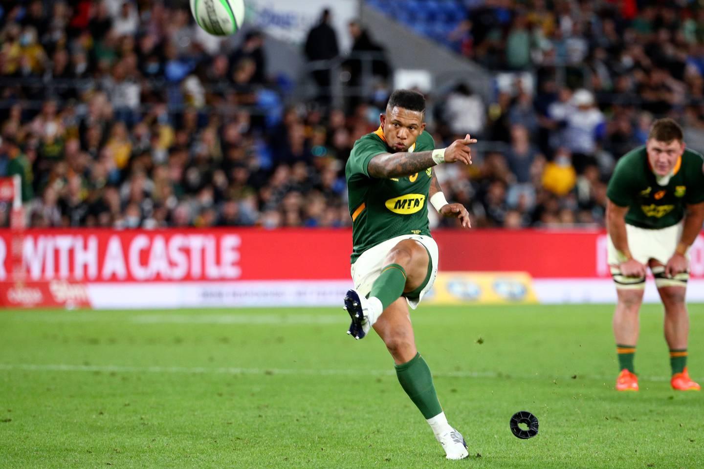 South Africa's Elton Jantjies kicks the winning penalty to beat the All Blacks. Photo / AP