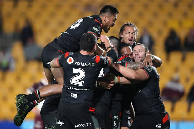 The Warriors celebrate after Jazz Tevaga of the Warriors scored a try during the round 21 NRL match between the New Zealand Warriors and the Manly Warringah Sea Eagles. Photo / Photosport.co.nz