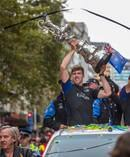 Team NZ helmsman, Peter Burling and Team NZ boss Grant Dalton hold aloft the America's Cup during the Emirates Team New Zealand victory Parade held in Auckland. Photo / Mark Mitchell