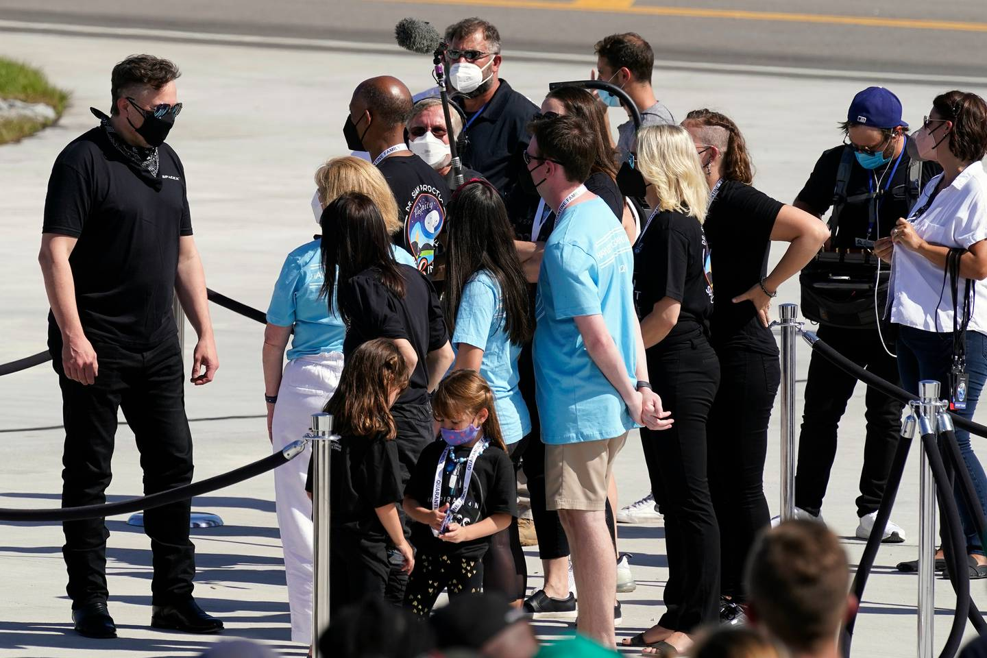 Elon Musk, founder, CEO, and chief engineer at SpaceX, left, talks to Inspiration4 passenger family members before the four head to the launch pad. Photo / AP