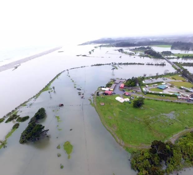 Floods on the Okuru River on the west coast. Photo / Kerry Eggeling