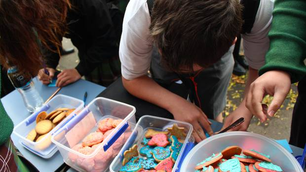 Whanganui High School students write out kind messages in exchange for a cookie as part of anti-bullying week. Photo / Caitlin Currie