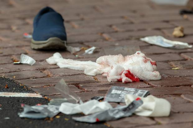 Bloodied bandages on the road following a shooting resulting in multiply fatalities and injuries at the Al Noor Mosque in Christchurch. Photo / SNPA