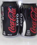 The size difference between the old 355ml can of coke and the new 330ml size. Photo / Supplied