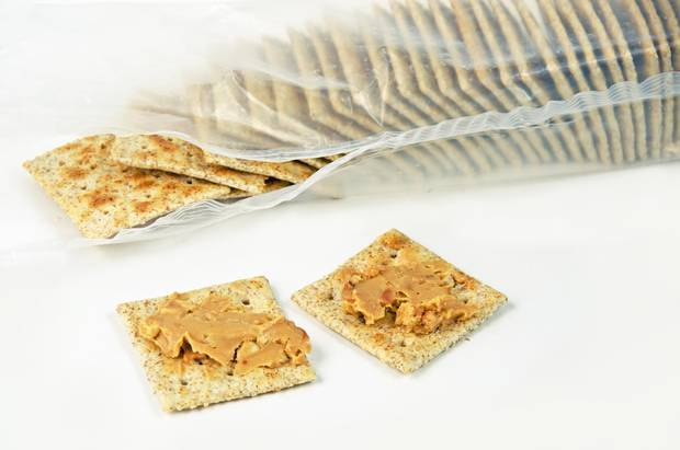 Certain wholegrains help boost serotonin levels. Try pairing crackers with peanut butter for a better night's sleep. Photo / Getty