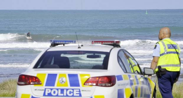 Police in Gisborne go to speak to surfers breaking lockdown rules. Photo / Gisborne Herald