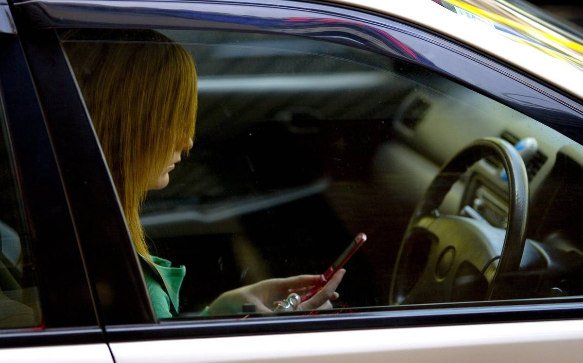 One driver in every three minutes caught using their cellphone in Wellington