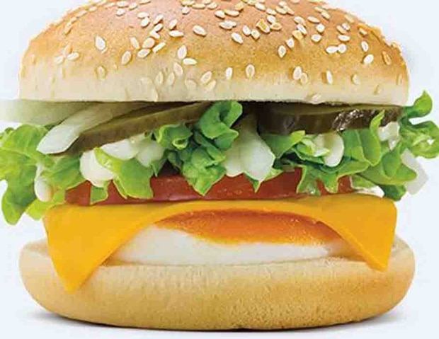 The McDonald's Salad Burger contains egg, cheese, McChicken sauce, lettuce, pickles and onion on a quarter pounder bun.