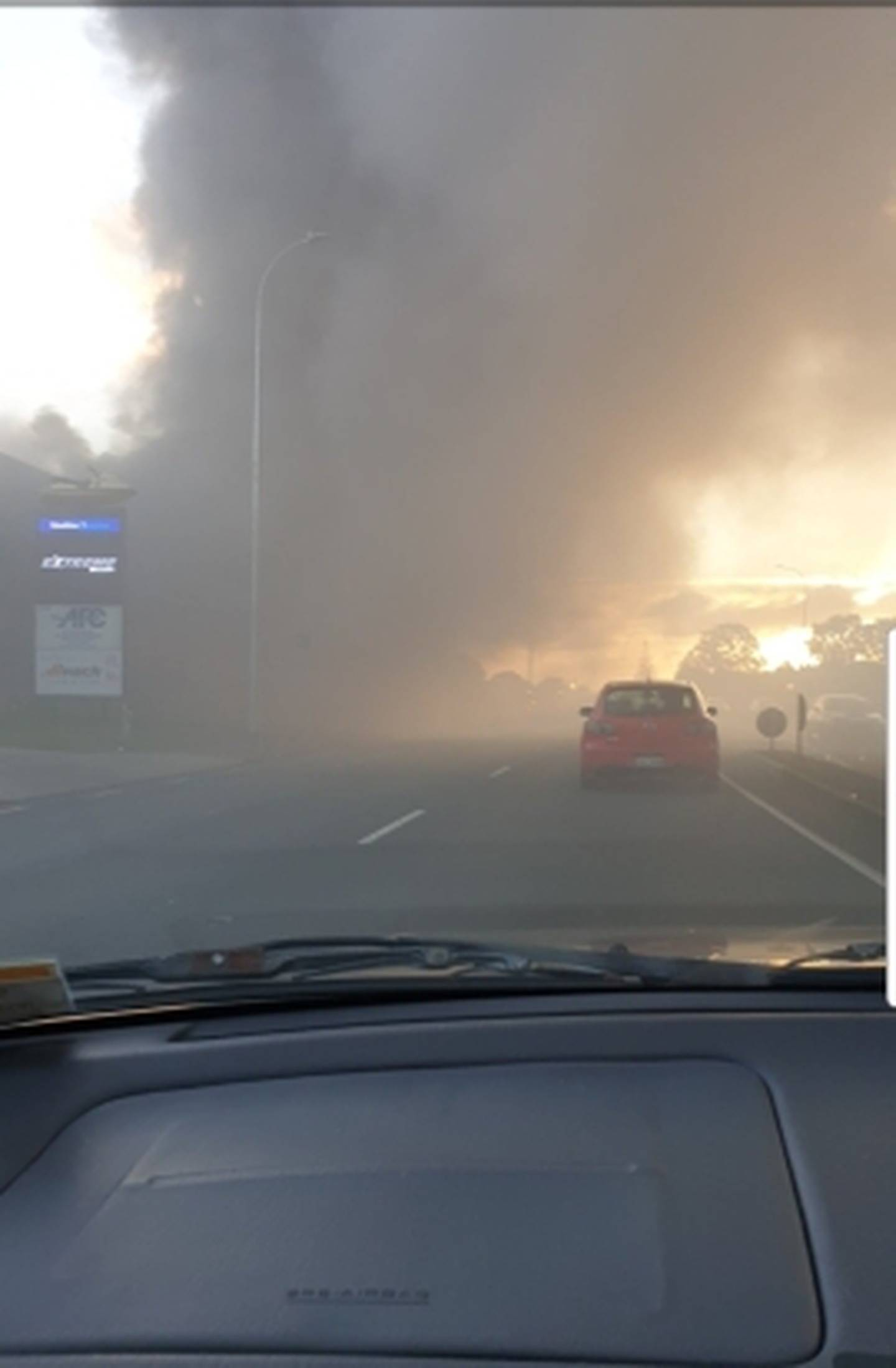 Smoke billowing from the building fire in Auckland's Burswood. Photo / Supplied