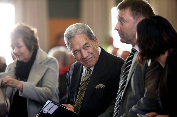 New Zealand First leader Winston Peters speaks with NZ First MP Mark Patterson at a public meeting held at the Invercargill Workingmen's club.