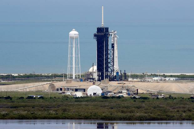A SpaceX Falcon 9, with Nasa astronauts Doug Hurley and Bob Behnken in the Dragon crew capsule, prepare to lift off from Pad 39-A at the Kennedy Space Centre in Cape Canaveral. Photo / AP