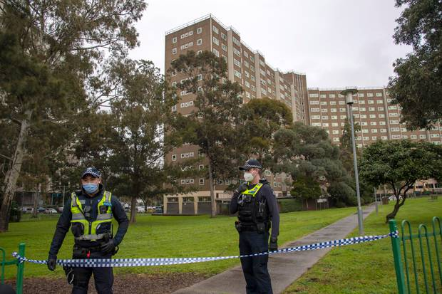 Police guard access to housing commission apartments under lockdown in Melbourne. Photo / Getty Images