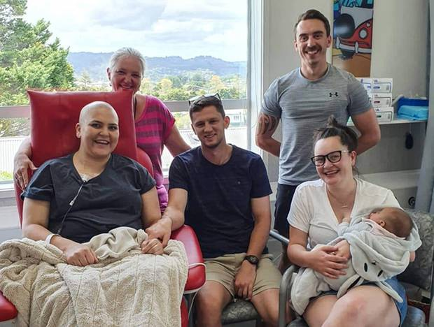 McIntyre undergoing chemotherapy, alongside her partner Andy Welsh, and other family members. Photo / Supplied