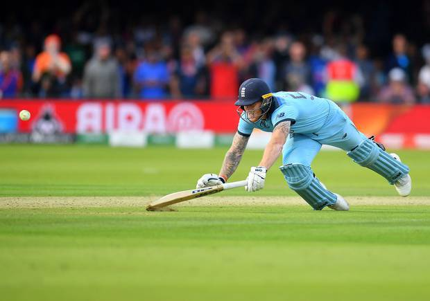 Ben Stokes dives to make his ground as the fielded ball hits his bat and runs away for four runs. Photo / Getty Images