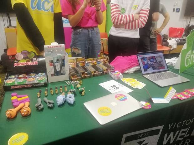 Photos of Young Act's O-week stall at the University show boxes of Shesha on display next to smoking devices - commonly used for consuming marijuana - and cannabis grinding devices.