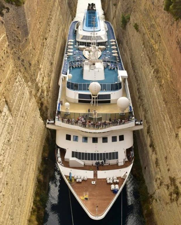 Cruise ship squeezes through canal in record-breaking voyage