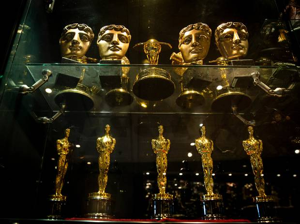 Some of the Academy Award Oscars and Baftas adorning the Weta Workshop boardroom. Photo / Mike Scott