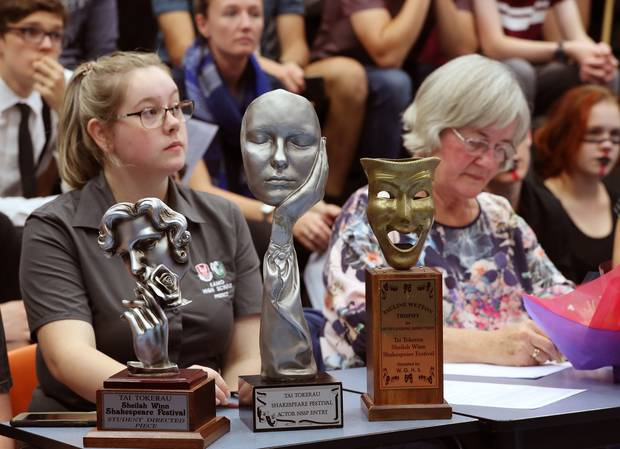 Student and Timekeeper Katelyn Stewart, left, and Jessie Bell, from Bellbird Speech and Drama, with the trophies for the winners. Photo / John Stone