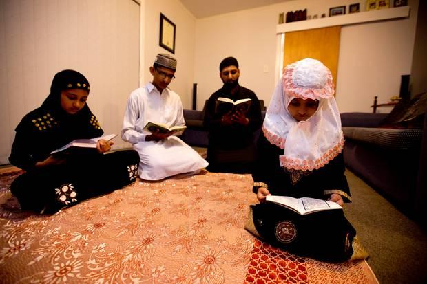 Siraj Akbar with his children preparing for Ramadan. Photo / File