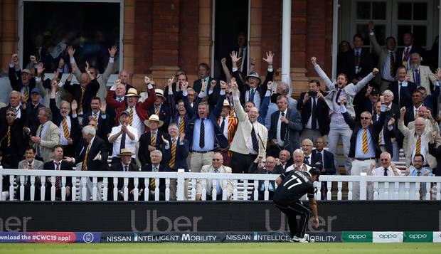 MCC members celebrate after England's Ben Stokes got a boundary from overthrows during the Cricket World Cup final match between England and New Zealand. Photo / AP