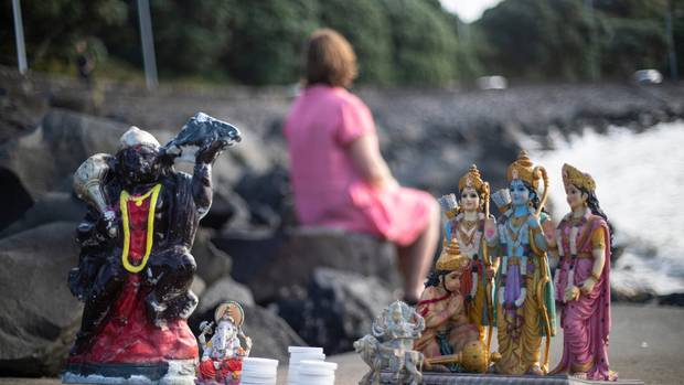 Rebecca at Biddick's Bay on Tamaki Drive, has been collecting Hindu deities left as rubbish on beaches. Photo / Jason Oxenham