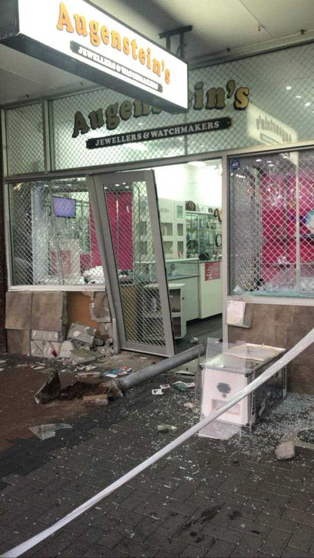 Thieves left behind a path of destruction at an Auckland jewellers, knocking down a steel pole and smashing through steel security doors. Photo / Facebook
