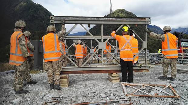 New Zealand Army personnel work on the replacement Bailey bridge over the Waiho River. Photo / NZDF