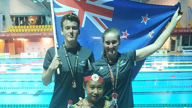 Rotorua's David Boles, left, and Stephanie Gillespie from Otago both won bronze medals in the Open Water 5km races. Photo / Supplied