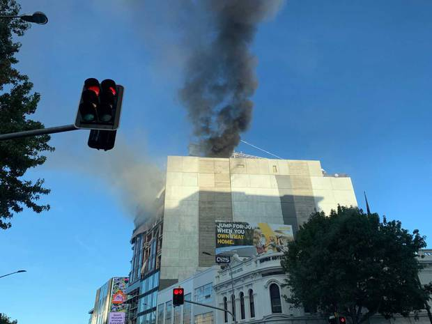 Smoke can be seen coming from the building site in Graham St.