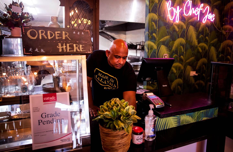 Joel Singam, owner of Panmure Malaysian restaurant Nasi Kander Palau Pinang, prepares to open under level 3 restrictions. Photo / Dean Purcell