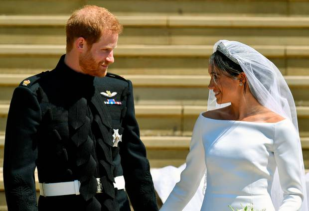 Britain's Prince Harry and Meghan Markle walk down the steps after their wedding at St. George's Chapel in Windsor Castle in Windsor, England. Photo / AP