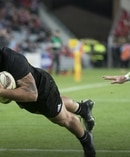 All Blacks hooker Codie Taylor scores the opening try. Photo / Brett Phibbs