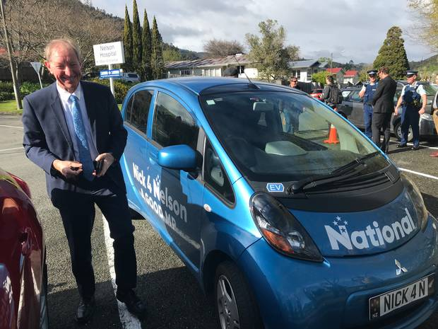 National MP Nick Smith in Nelson with his car. Photo / Derek Cheng