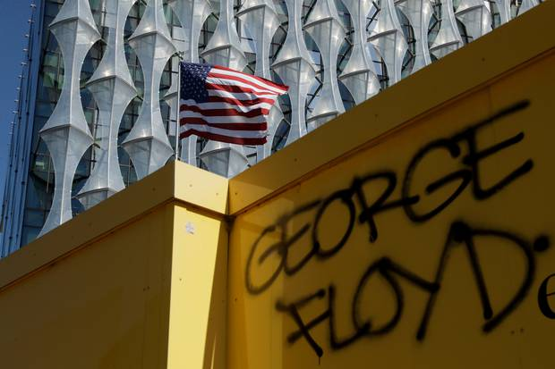George Floyd's name is written outside the US embassy after people marched there from Trafalgar Square in central London yesterday. Photo / AP