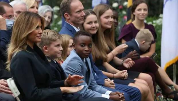 First Lady Melania Trump alongside Judge Barrett's husband and children. Photo / Getty Images
