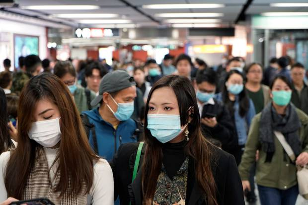 Passengers wear masks to prevent an outbreak of a new coronavirus in a subway station, in Hong Kong. Photo / AP