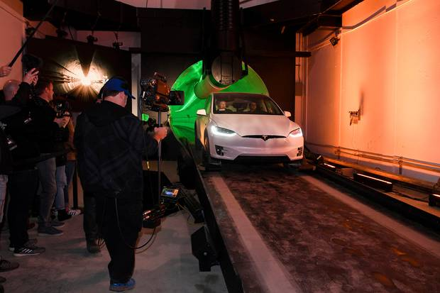 Elon Musk arrives in a modified Tesla Model X at the Hawthorne test tunnel in LA. Photo / AP