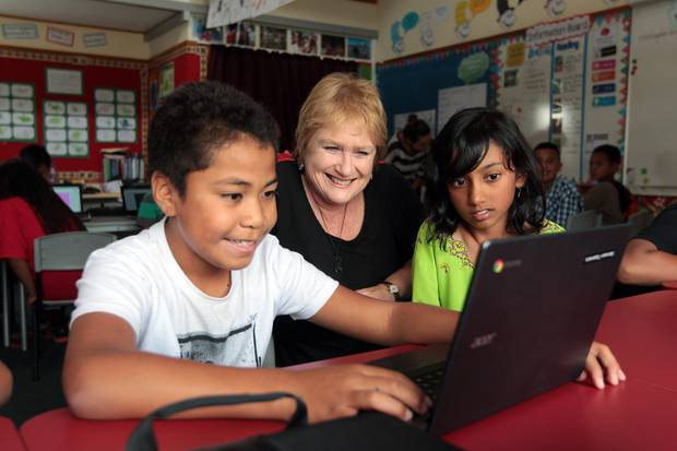 Lynda Stuart, pictured with May Rd School students Bronson Tipama'a, left, and Jumaanah Vahora in 2014, says schools don't want to see parents having to pay for teacher aides. Photo / File