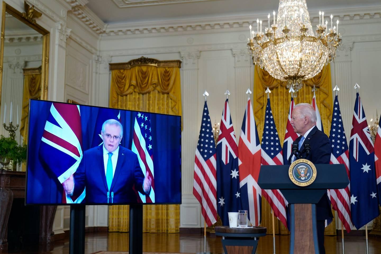 President Joe Biden, listens as he is joined virtually by Australian Prime Minister Scott Morrison and British Prime Minister Boris Johnson. Photo / AP