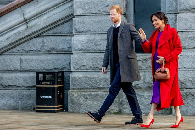 Britain's Prince Harry and Meghan, Duchess of Sussex greet the crowds of people during a visit to Birkenhead. Photo / AP