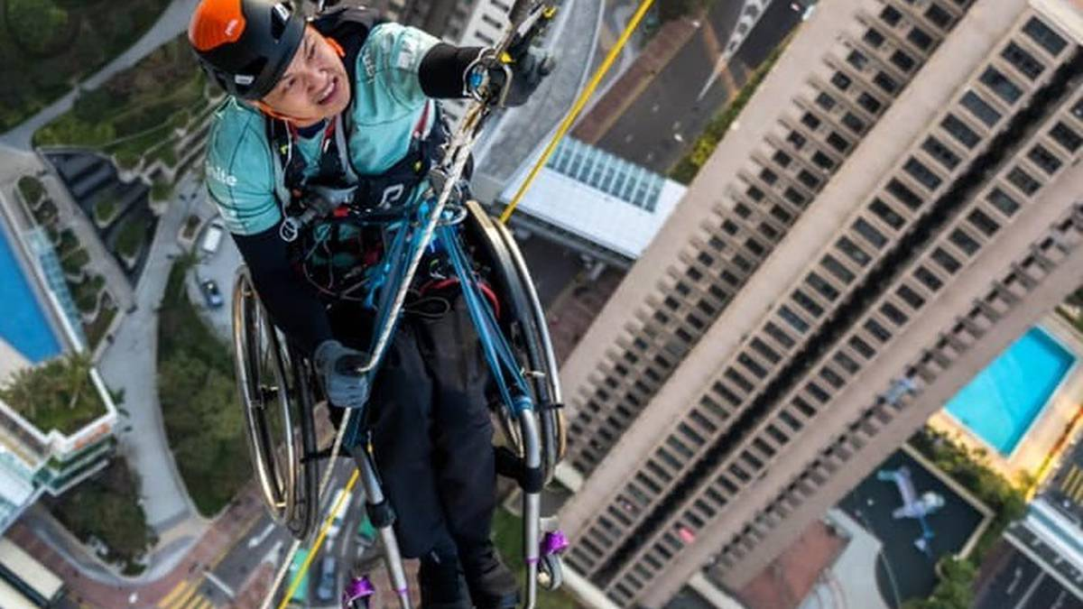 Paraplegic climber Lai Chi-wai scales Hong Kong skyline for spinal harm charity – NZ Herald