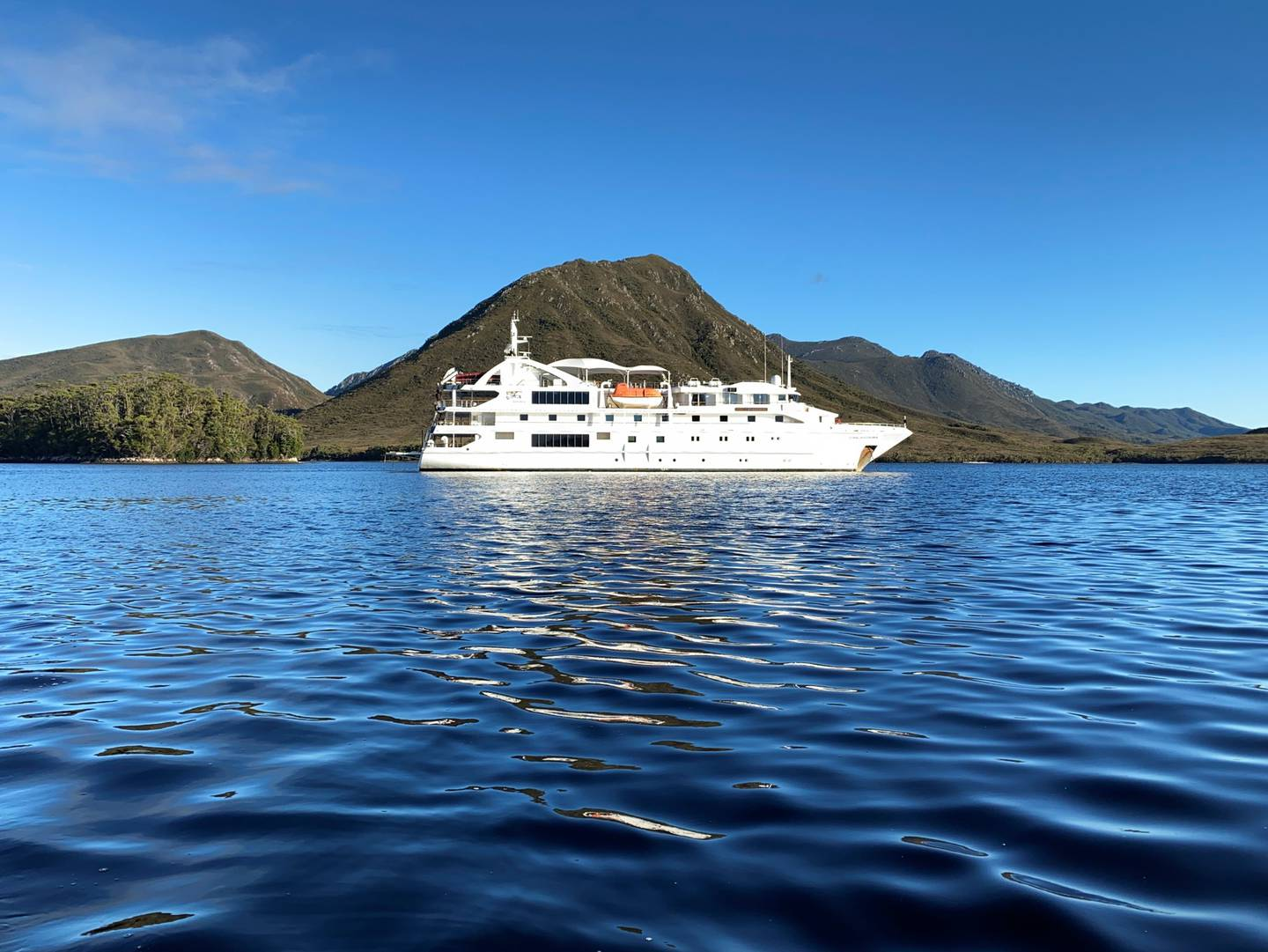 Coral Discoverer moored at Port Davey. Photo / Tiana Templeman, Supplied